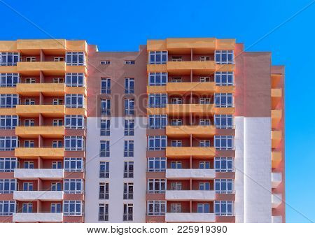 Apartment Building Construction Site On Blue Sky Background