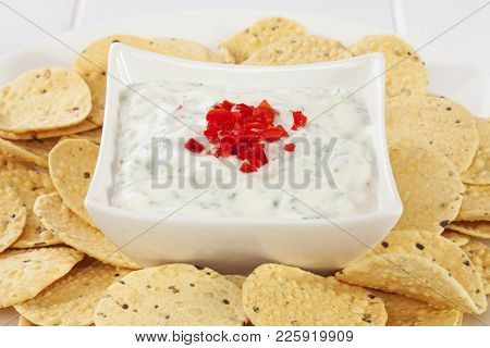 Popular Accompaniment To Indian Meals, Cucumber Raita Topped With Chilli, Surrounded By Mini Poppadu