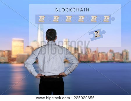 Blockchain Schematic On Glass Panel With Senior Technology Executive Looking At The Chart With New Y