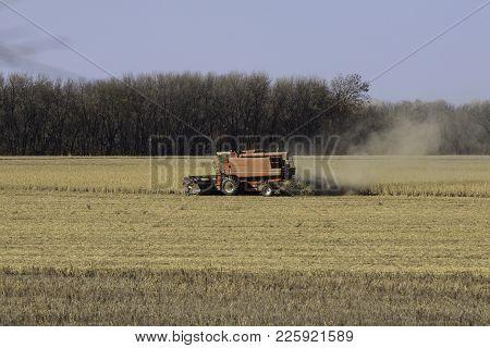 Grain Crop Harvest By Combine Machine In Kansas
