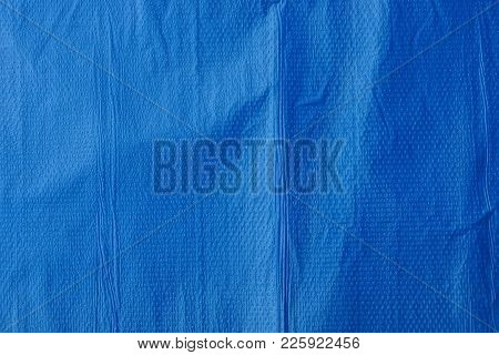 Plastic Texture Of A Piece Of Crumpled Blue Cellophane