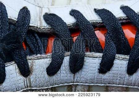 Black Shoelaces On A Colored Leather Boot