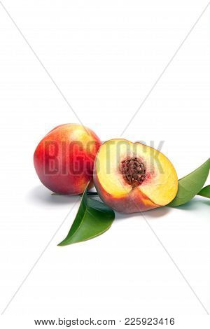 One And A Half Nectarine Peaches Isolated On White Background