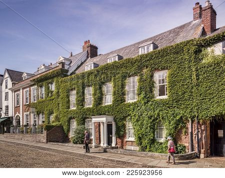 20 June 2017: Exeter, Devon, Uk - Houses In Cathedral Close, Exeter, Across The Green From The Cathe