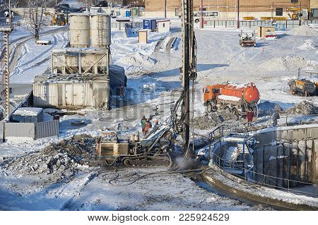 Moscow, Feb. 01, 2018: Winter View On Dirty Heavy Construction Equipment, Vehicles And Workers At Wo