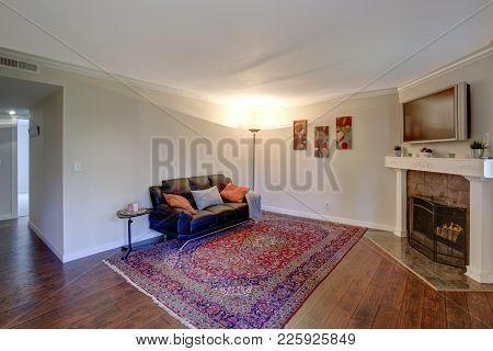 Interior Of A Living Room With Corner Fireplace.