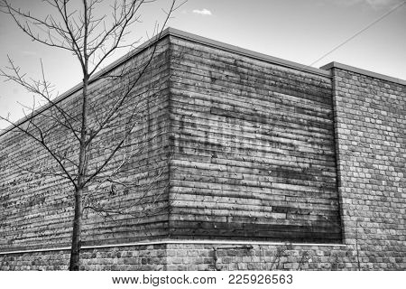 Abstract architecture background with wood and brick walls building exterior against sky