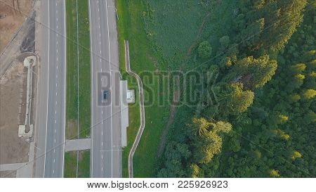 Highway Road Between Trees. Clip. Aerial View Of Truck Driving At Highway Road At Green Forest. Asph