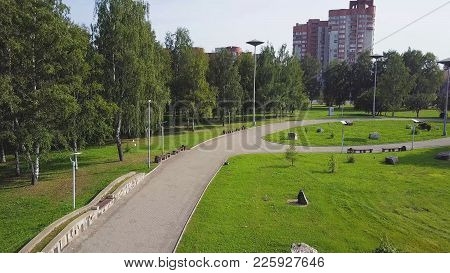Road Near The Green Park, Top View. Green Park And Its Vast Lawns On A Sunny Spring Day. Clip. Aeria
