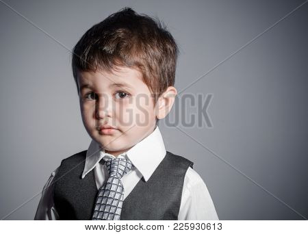 delusion, little businessman, brown-haired boy dressed in suit and tie with faces and funny expressions