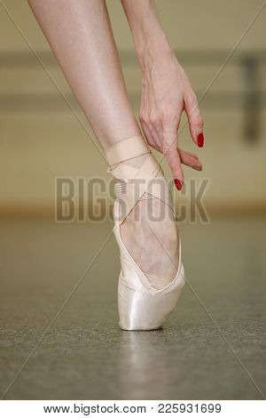 Foot Ballerina In Pointe Shoes. Beautiful Graceful Hand. Rehearsal Of The Dance On Tiptoe. Shooting