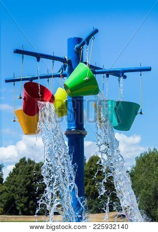 Color Bucks Of Cool Water At A Fun Water Park.