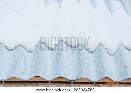 Snow On The Roof. The Snow Lies On The Iron Shingles.