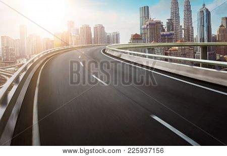 Panoramic View Of Asphalt Road Side With Beautiful Kuala Lumpur City Waterfront Skyline. Night Scene