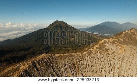 Mountain Landscape, Clouds, Relief. Aerial View Of Green Tropical Mountain Cover With Cloud Banyuwan