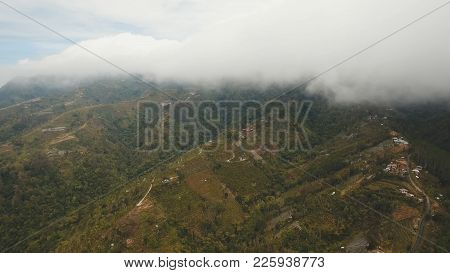 Aerial View Of Farmland In The Mountains, Fields, Trees With White Fog, Clouds Bali, Indonesia. Fog,