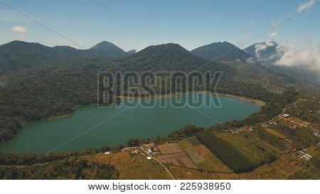 Aerial View Of Lake Tamblingan, A Caldera Lake At Bali. Beautiful Lake With Turquoise Water In The M