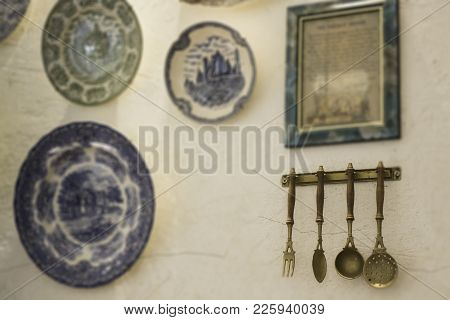 Kitchen Rack Hanging With Kitchen Utensils, Stock Photo