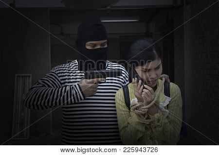 Terrorist Man Holding Gun Kidnapping Woman For A Hostage In Construction Site, Woman Calling The Pol
