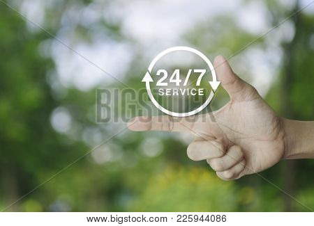 24 Hours Service Icon On Finger Over Blur Green Tree Background, Full Time Service Concept