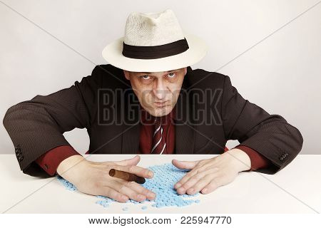 Older Dealer Of Extasy Pills Counting And Checking Lot Of Pills