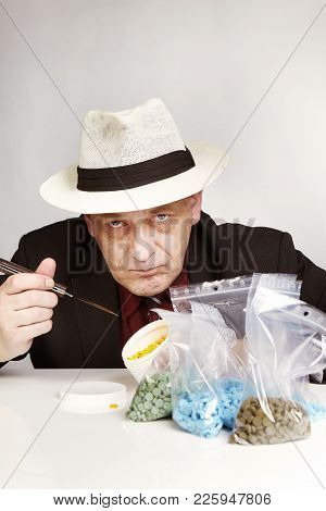 Older Dealer Of Mdma Drugs Counting Lot Of Pills