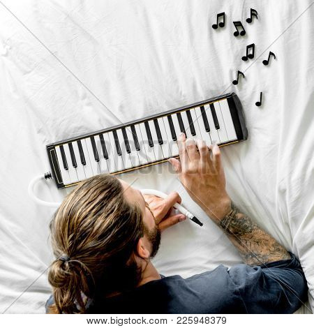 Man playing music on the bed