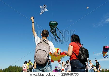 Moscow, Russia - August 27, 2016: People Launche A Kite Into The Sky At The Kite Festival In The Par