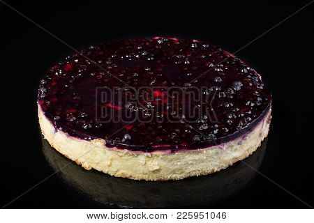 Cake Cheesecake With Cherry In Jelly On Black Background