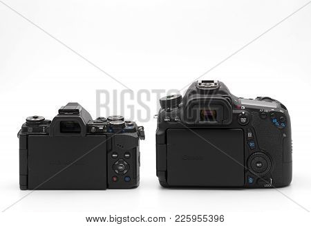 Bangkok, Thailand - February 09, 2018 : Back View Of Mirrorless Camera And Dslr Camera Isolated On W