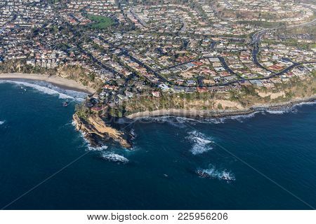 Aerial view of Mussel Cove area beaches, streets and homes in Dana Point California.