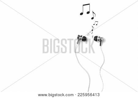 Earphones And Musical Notes On White Background