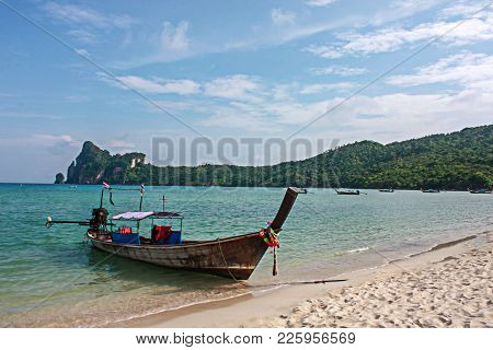 Long Tail Boat At Pi Pi Island Beach With Blue Sea Mountain And Sky, Thailand