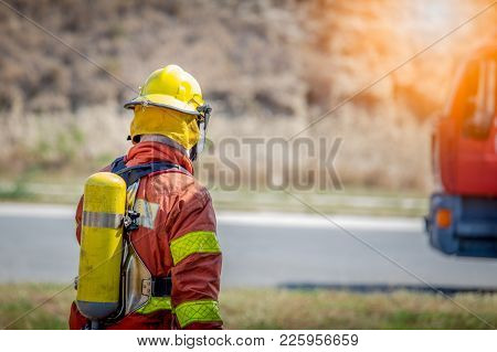 Fireman Walk To Fire Truck With Copy Space And Flare