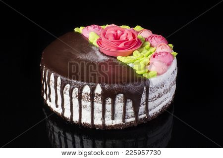 Luxurious Chocolate-covered Cake Decorated With Roses From Oil Cream On A Black Background