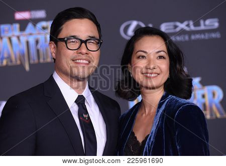 LOS ANGELES - JAN 29:  Randall Park and Jae Suh Park arrives for the 'Black Panther' World Premiere on January 29, 2018 in Hollywood, CA