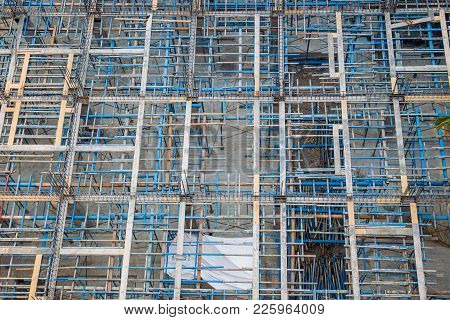 Metal Scaffold Set Up For Heavy Building Construction From Above Angle.