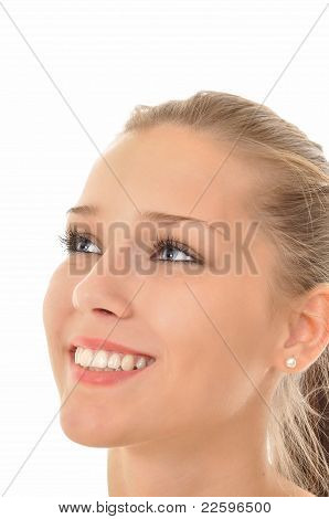 Woman with blue eyes looking into the sky