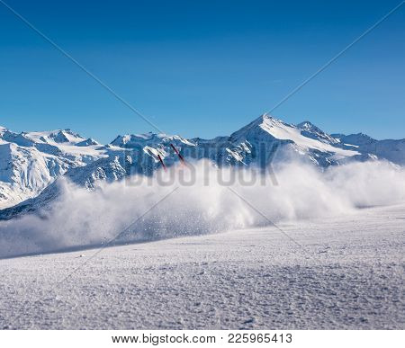 Flying Snow Powder At A Downhill Ski Course In The Italian Alps With Stunning Mountainscape Backgrou