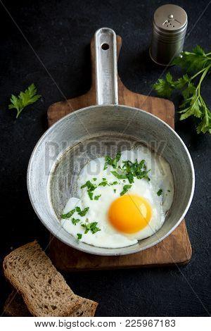 Fried Egg On Frying Pan For Breakfast