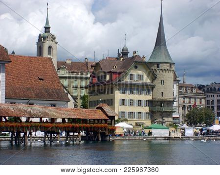 Lucerne, Switzerland - July 25, 2009 : Historic City Center Of Lucerne With Beautiful Chapel Bridge