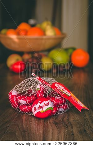 February 10th, 2018, Cork, Ireland - Babybel Cheese On Top Of A Wooden Table With Healthy Fruit In T