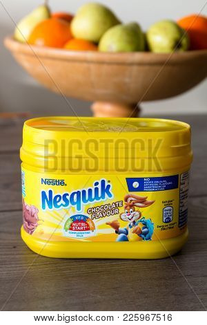 February 10th, 2018, Cork, Ireland - Nestlé Nesquik Container On Top Of A Wooden Table With Healthy