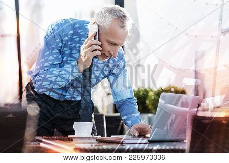 Phone Talk. Smart Professional Mature Businessman Having A Busy Working Day And Talking On The Phone