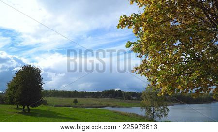 Autumn Landscape In The Countryside, Lake, Sky, Autumn Day.autumn Maple Leaves On A Tree.maple Leave