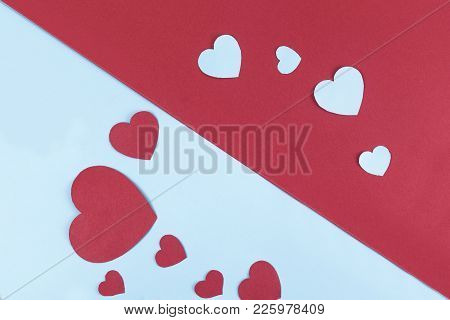 Love Concept. Heart Cut Outs In Dual Colored Background.