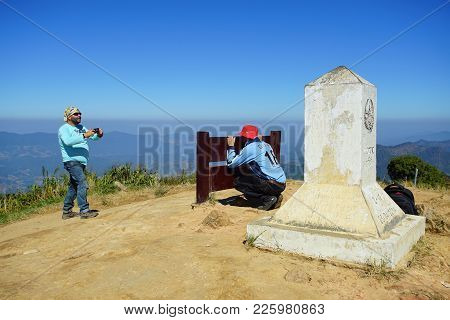 Chiang Rai, Thailand - December 22, 2017: Tourists Taking A Photo In Front Of The Pole Of Phu Chee F