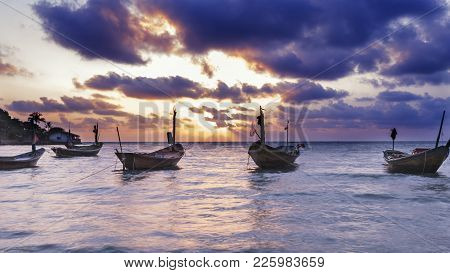 Fisherman Boat At Rayong Beach Thailand, Fishing Boat Parked On The Beach With Beautiful Sky.