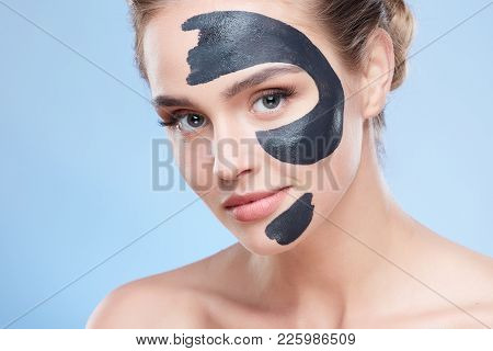 Head And Shoulders Of Girl With Grey Mask