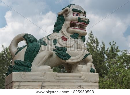 Coorg, India - October 29, 2013: The Guardian Statue Of The Mutached Snow Lion On The Step Of The Pa
